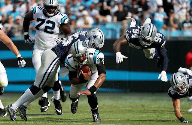 <p>Cam Newton #1 of the Carolina Panthers runs the ball against Randy Gregory #94 of the Dallas Cowboys in the first quarter during their game at Bank of America Stadium on September 9, 2018 in Charlotte, North Carolina. (Photo by Streeter Lecka/Getty Images) </p>