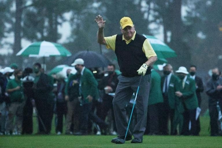 Jack Nicklaus waves after hitting an honorary opening tee shot at Augusta National, where an early weather delay ensured the first round of the Masters wouldn't finish on schedule