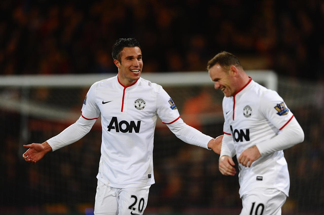 LONDON, ENGLAND - FEBRUARY 22: Robin Van Persie of Manchester United celebrates the first goal with Wayne Rooney during the Barclays Premier League match between Crystal Palace and Manchester United at Selhurst Park on February 22, 2014 in London, England. (Photo by Laurence Griffiths/Getty Images)