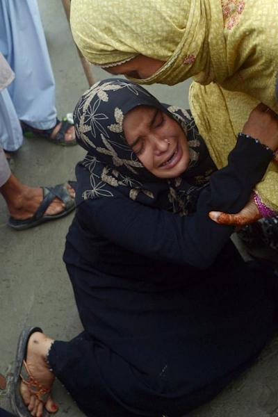 Pakistani women mourn after their drowned brother's body was recovered at Clifton beach in Karachi on August 1, 2014