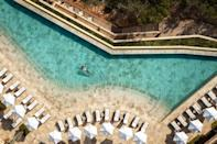 """<p>Perched on the very northern tip of the island, <a href=""""https://www.booking.com/hotel/es/six-senses-ibiza.en-gb.html?aid=2070929&label=ibiza-hotels"""" rel=""""nofollow noopener"""" target=""""_blank"""" data-ylk=""""slk:Six Senses Ibiza"""" class=""""link rapid-noclick-resp"""">Six Senses Ibiza</a> is all about sustainable and eco-friendly luxury. But this is far from a hemp-knitting commune. Here, you can indulge in swish cave suites, a spiritual centre and a farm-to-fork dining ethos - Our Farm is a 400-year-old olive press and agricultural estate which supplies the restaurants, cafes and juice bars in the resort. </p><p>Discover true bliss in the Six Senses Spa, which also has a Rose Bar longevity lounge and a holistic anti-aging programme. Or watch the sunset over cocktails at the Beach Caves, the hotel's incredibly cool live music venue. And naturally, being Ibiza, there's also a recording studio should inspiration call.</p><p><a class=""""link rapid-noclick-resp"""" href=""""https://www.booking.com/hotel/es/six-senses-ibiza.en-gb.html?aid=2070929&label=ibiza-hotels"""" rel=""""nofollow noopener"""" target=""""_blank"""" data-ylk=""""slk:CHECK AVAILABILITY"""">CHECK AVAILABILITY</a></p>"""