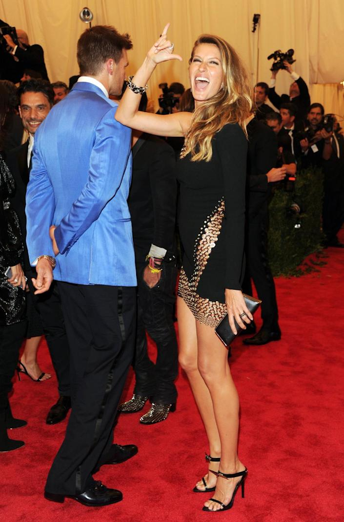 """Tom Brady and Gisele Bundchen attend The Metropolitan Museum of Art's Costume Institute benefit celebrating """"PUNK: Chaos to Couture"""" on Monday, May 6, 2013 in New York. (Photo by Evan Agostini/Invision/AP)"""