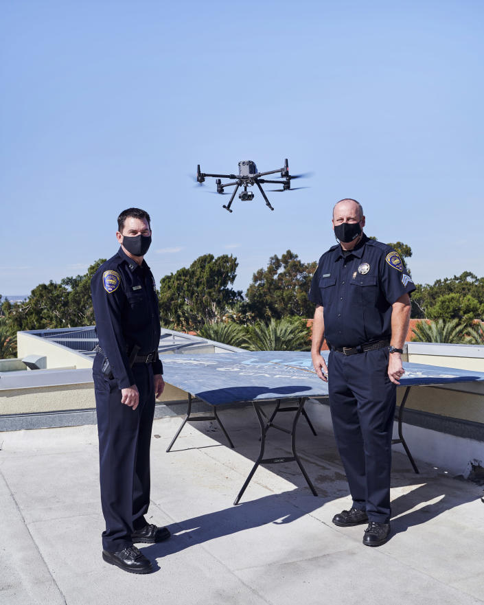 Capt. Don Redmond, left, and Sgt. James Horst with a drone used for police operations, in Chula Vista, Calif., on Nov. 11, 2020. (John Francis Peters/The New York Times)