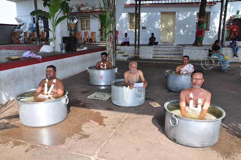 Hindu priests perform the 'Parjanya Japa' and offer prayers to appease the rain god for timely monsoon rains (AFP Photo/STR)