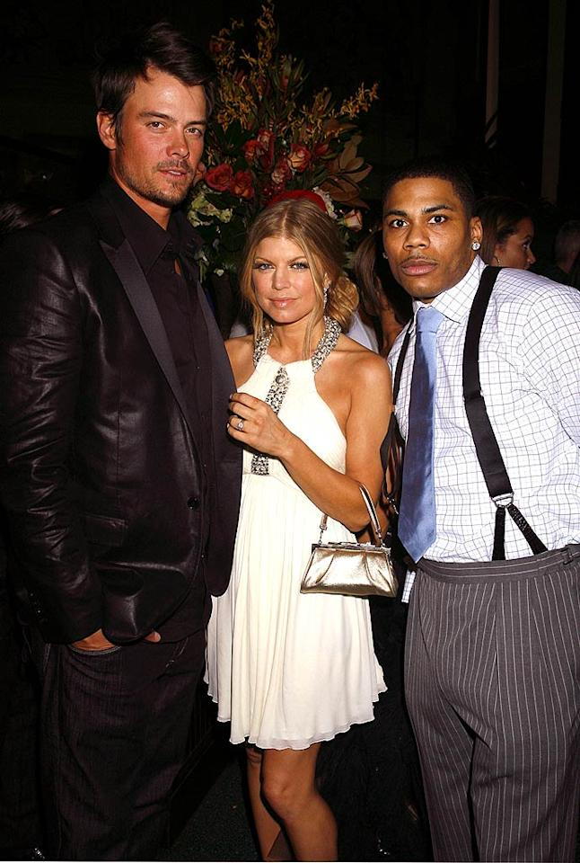 "Fergie's ""Glamorous"" evening concluded with a pit stop at her record label's after party. Apparently ""Big Girls Don't Cry"" when surrounded by Josh Duhamel (""Las Vegas"") and Nelly! Jeffrey Mayer/<a href=""http://www.wireimage.com"" target=""new"">WireImage.com</a> - February 10, 2008"