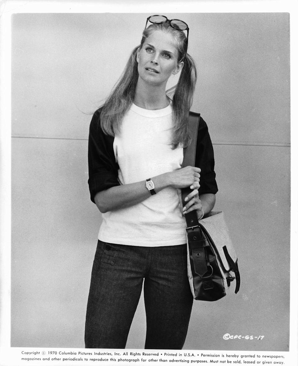 <p>More bohemian and casual styles gained traction in the '70s, like shoulder bags with wider, longer straps. They were also larger and usually featured buckles, like this one on Candice Bergen. </p>