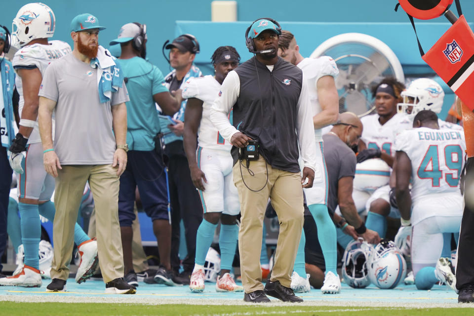 Miami Dolphins head coach Brian Flores walks the sidelines during the second half of an NFL football game against the Buffalo Bills, Sunday, Sept. 19, 2021, in Miami Gardens, Fla. The Bills defeated the Dolphins 35-0. (AP Photo/Hans Deryk)