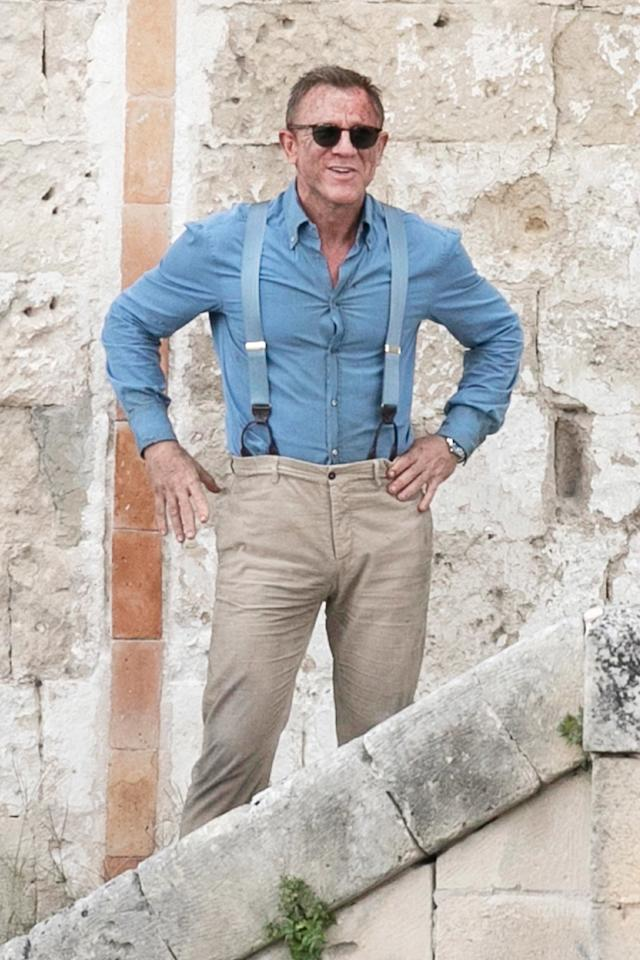 Daniel Craig gets rough around the edges on Tuesday while filming the new Bond movie,<em> No Time to Die,</em> in Matera, Italy.