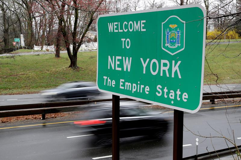 A sign welcomes motorists to New York, on the border with Connecticut, near Rye Brook, N.Y., Sunday, March 29, 2020.