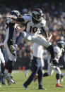 Denver Broncos wide receiver Emmanuel Sanders (10) celebrates with wide receiver Wes Welker after catching a 32-yard touchdown pass against the Oakland Raiders during the second quarter of an NFL football game in Oakland, Calif., Sunday, Nov. 9, 2014. (AP Photo/Marcio Jose Sanchez)