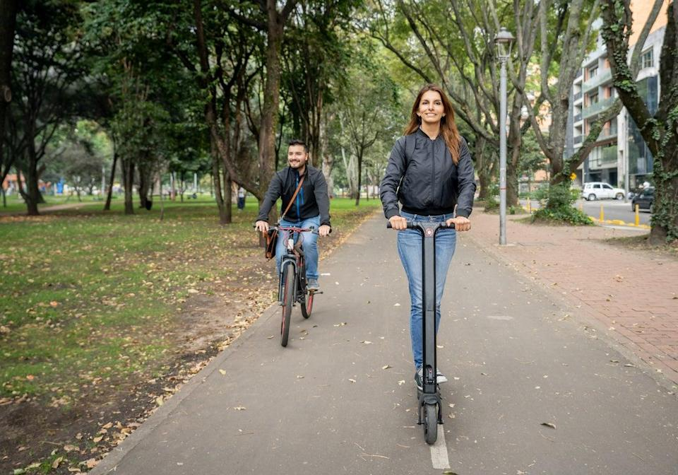<p>Lightweight vehicles like bikes, scooters and mopeds, designed for short trips around cities, take up less space on the road and require less energy to power</p> (Getty)