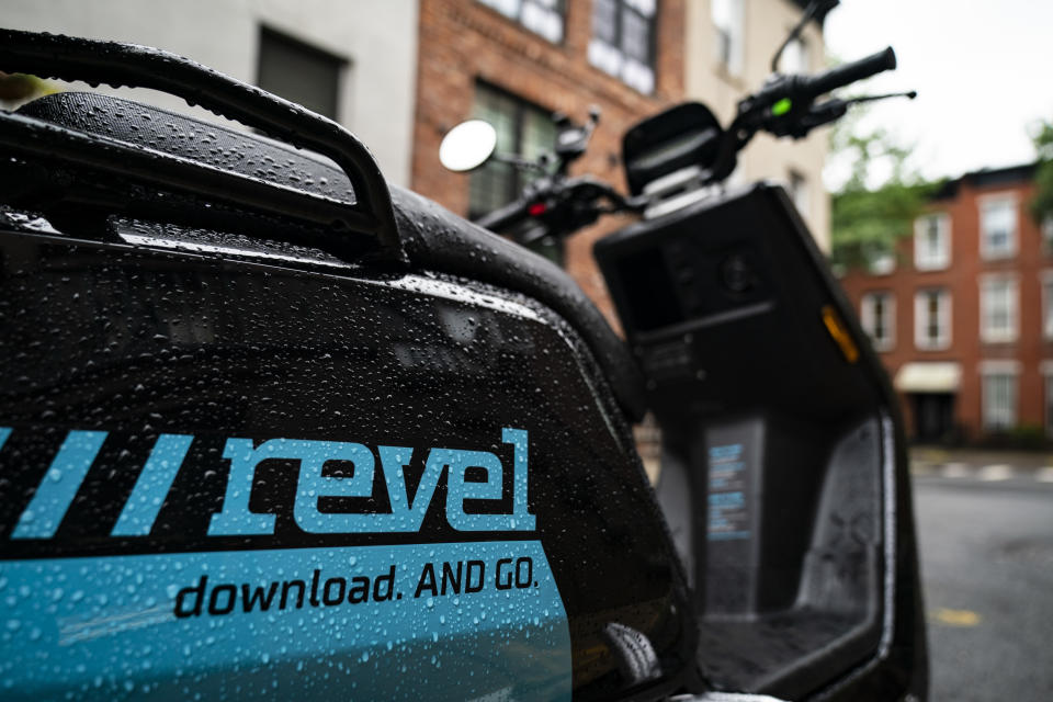 NEW YORK, NY - JUNE 18: A Revel brand moped sits parked on a residential street, June 18, 2019 in the Brooklyn borough of New York City. The ride-share moped company has deployed over 1,000 electric mopeds through Brooklyn and Queens. The fully electric mopeds top out at 30 miles per hour and are available to rent by the minute via smartphone. (Photo by Drew Angerer/Getty Images)