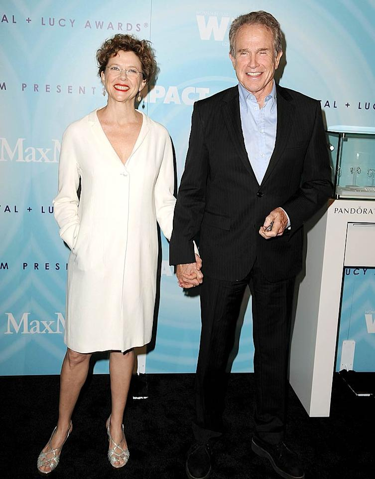 """Happy couple Annette Bening and Warren Beatty are still holding hands on the red carpet after 19 years of marriage! Annette received one of the night's biggest honors -- the Crystal Award -- to commemorate the 53-year-old's distinguished acting career. Steve Granitz/<a href=""""http://www.wireimage.com"""" target=""""new"""">WireImage.com</a> - June 16, 2011"""