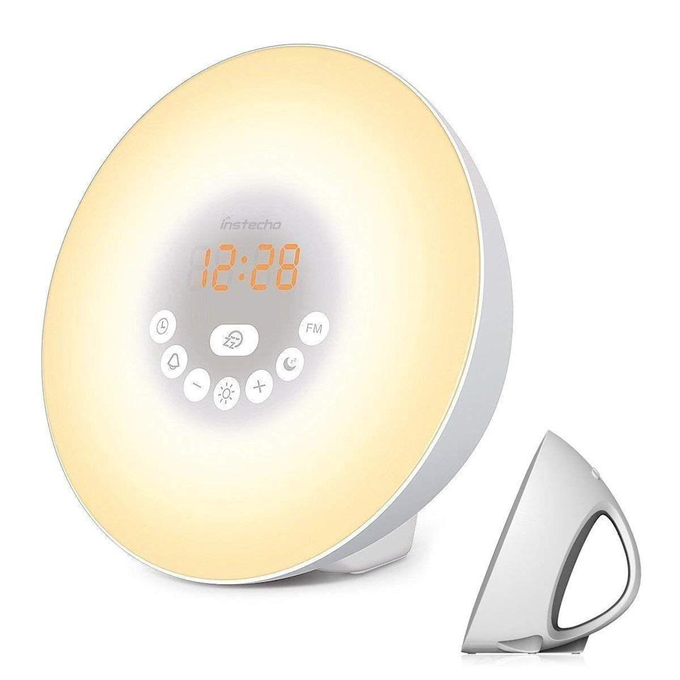 """<p><strong>Best For: Price Point</strong><br>An Amazon Choice buy, this wake-up clock boasts multiple colors and brightness scales ontop of a sleek design and affordable price point.</p><br><br><strong>instecho</strong> Sunrise Alarm Clock, Digital Clock, $29.99, available at <a href=""""https://www.amazon.com/instecho-Sunrise-Digital-Nature-Control/dp/B07GJKYWM8/ref=sr_1_4?ie=UTF8&qid=1541190556&sr=8-4&keywords=light+alarm+clock"""" rel=""""nofollow noopener"""" target=""""_blank"""" data-ylk=""""slk:Amazon"""" class=""""link rapid-noclick-resp"""">Amazon</a>"""