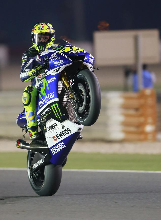 Yamaha MotoGP rider Valentino Rossi of Italy rides his bike during a free practice session at the MotoGP World Championship at the Losail International circuit in Doha March 20, 2014. Mohammed Dabbous (QATAR - Tags: SPORT MOTORSPORT)