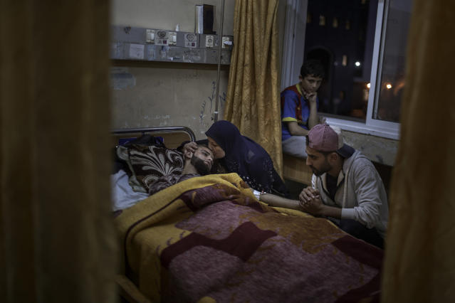"<p>Ahmad Kanaan, 21, is sourrended by his mother and relatives at Gaza's Shifa hospital on April 20, 2018. The Palestinian man has been injured by Israeli troops while protesting for ""The Great March of Return"" along the Gaza Strip's border with Israel. (Photo: Fabio Bucciarelli for Yahoo News) </p>"