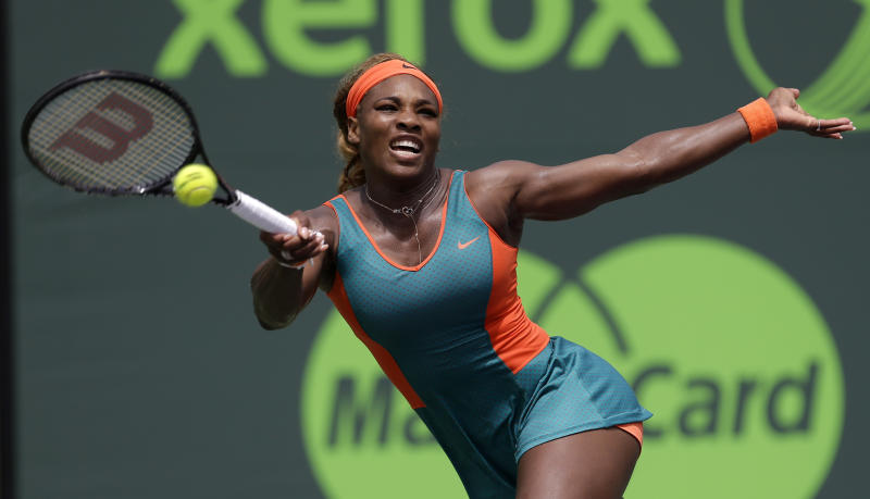Serena Williams, of the United States, returns to Caroline Garcia, of France, at the Sony Open tennis tournament in Key Biscayne, Fla., Saturday, March 22, 2014. (AP Photo/Alan Diaz)