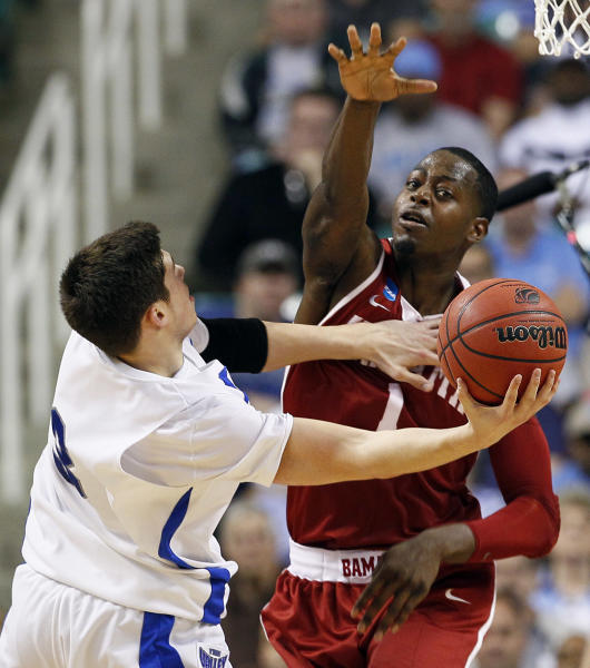Alabama's JaMychal Green (1) blocks Creighton's Doug McDermott (3) during the first half of a Midwest Regional NCAA tournament second-round college basketball game in Greensboro, N.C., Friday, March 16, 2012. (AP Photo/Gerry Broome)