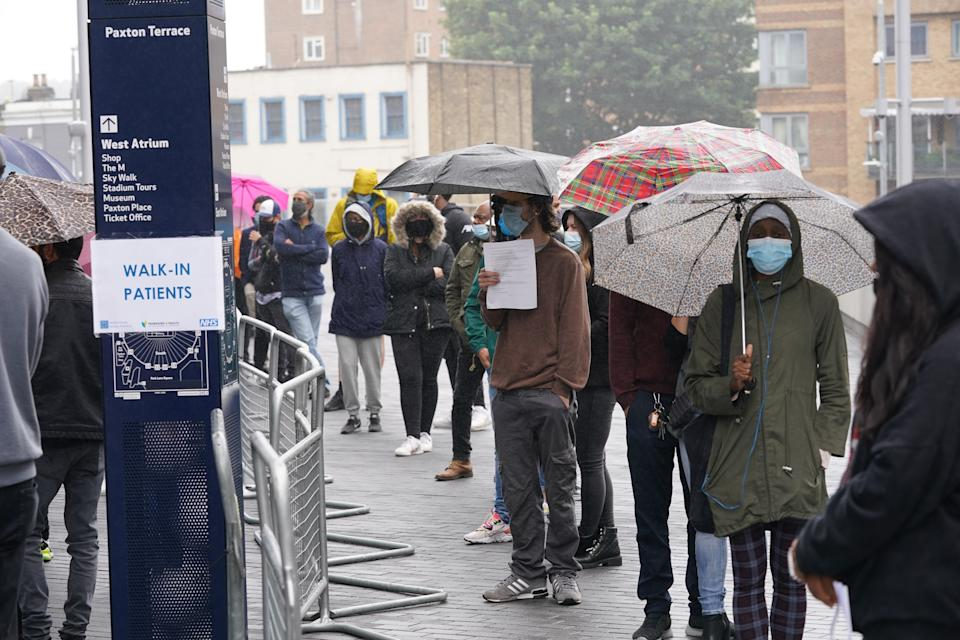 People queue at an NHS Vaccination Clinic at Tottenham Hotspur's stadium in north London. The NHS is braced for high demand as anyone in England over the age of 18 can now book a Covid-19 vaccination jab. Picture date: Sunday June 20, 2021.