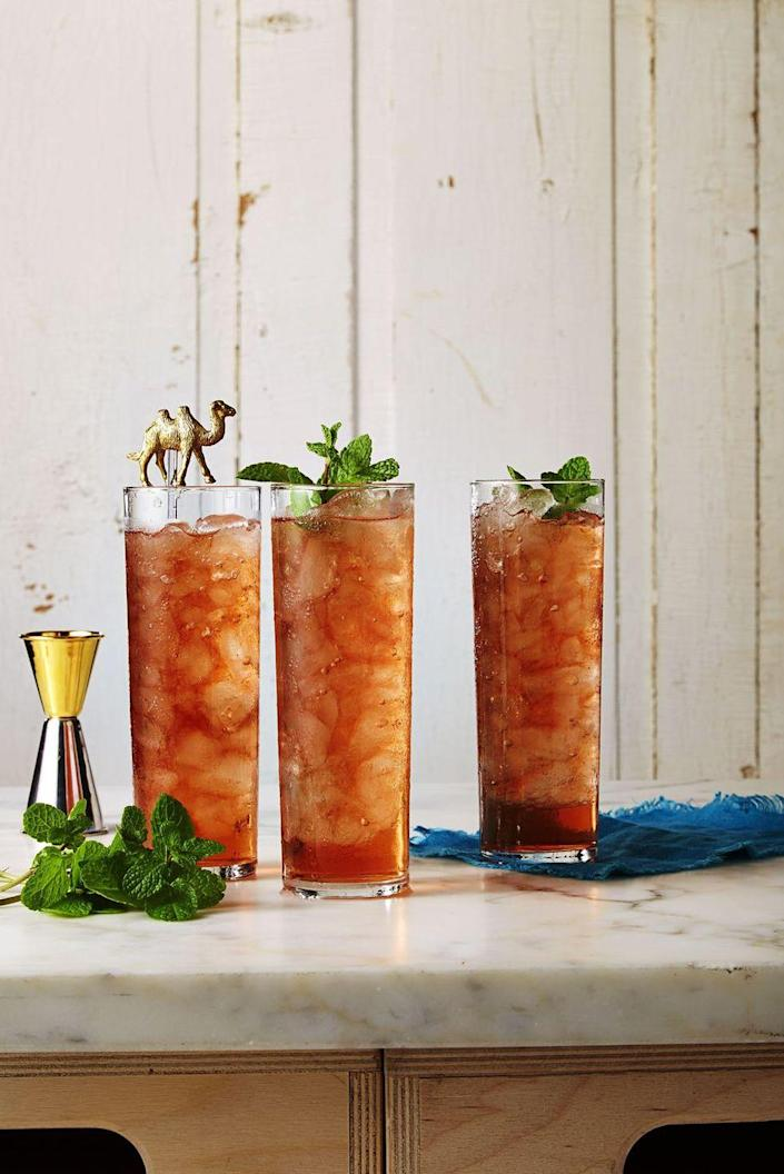 """<p>This refreshing spin on sweet tea is sure to kick any backyard party up a notch. </p><p><u><em>Get the recipe from <a href=""""https://www.goodhousekeeping.com/food-recipes/a37455/peach-sweet-tea-with-bourbon-recipe/"""" rel=""""nofollow noopener"""" target=""""_blank"""" data-ylk=""""slk:Good Housekeeping"""" class=""""link rapid-noclick-resp"""">Good Housekeeping</a>. </em></u></p>"""