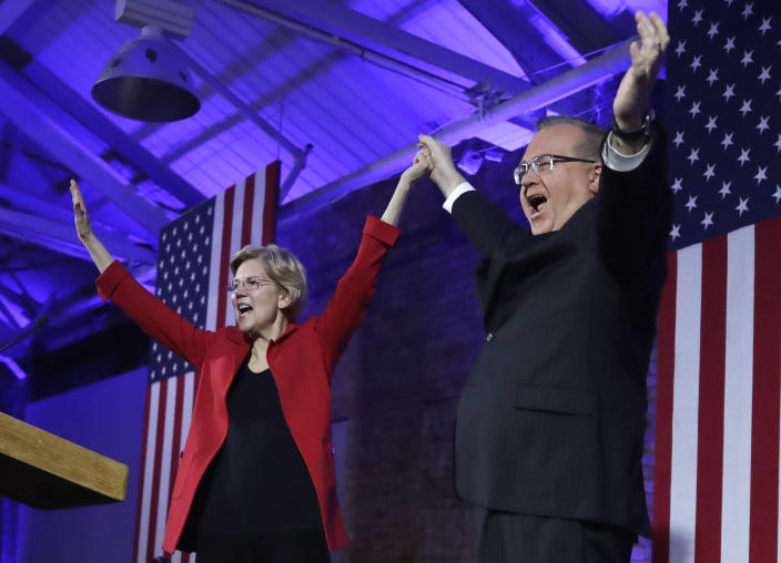 Democratic presidential candidate Sen. Elizabeth Warren, D-Mass., and New Hampshire Democratic Party Chairman Ray Buckley acknowledge applause at the New Hampshire Democratic Party's 60th Annual McIntyre-Shaheen 100 Club Dinner, Friday, Feb. 22, 2019, in Manchester, N.H. (AP Photo/Elise Amendola)