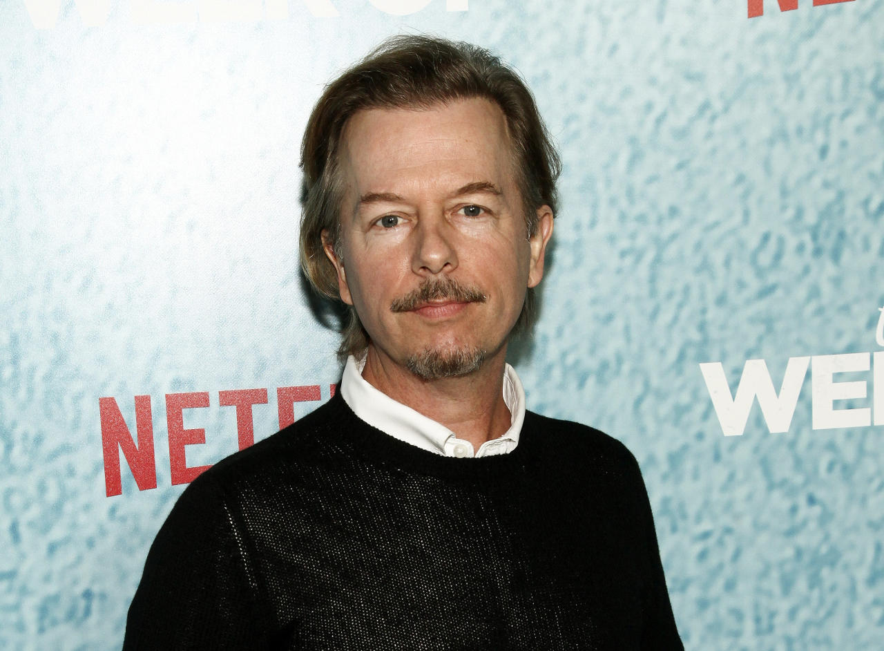 "FILE - In this April 23, 2018 file photo, David Spade attends the premiere of Netflix's ""The Week Of"" in New York. Spade says his family is coming together after the death of his sister-in-law Kate Spade. The fashion designer killed herself in June. (Photo by Andy Kropa/Invision/AP, File)"