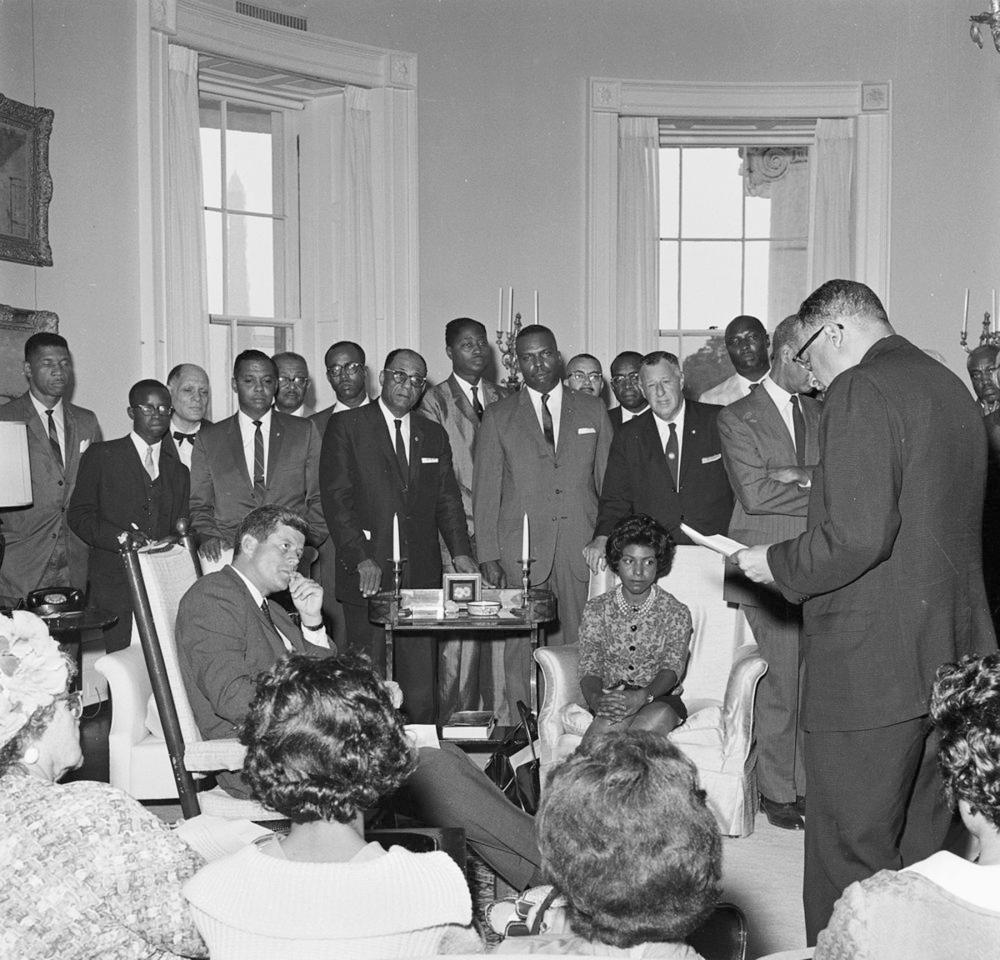 """Then U.S. President John F. Kennedy meets with representatives from the National Association for the Advancement of Colored People (NAACP) in the Oval Office at the White House, Washington in this July 12, 1961 handout photo provided by John F. Kennedy Presidential Library and Museum. President Kennedy (seated in rocking chair); Bishop Stephen G. Spottswood, Chairman of the NAACP Board of Directors (standing right, back to camera). Standing, rear (L - R): Medgar Evers, Mississippi NAACP Field Secretary; Calvin Luper, Oklahoma City NAACP Youth Council President; Edward Turner, President of Detroit NAACP branch; Jack E. Tanner, Northwest Area Conference NAACP President; unidentified man; Rev. W.J. Hodge; Dr. S.Y. Nixson; C.R. Darden, President of Mississippi NAACP State Conference branches; Kelly M. Alexander, member of NAACP Board of Directors; two unidentified men (partially hidden, at back); Kivie Kaplan, Chairman of NAACP Life Membership Committee; others unidentified. The rocking chair used by President John F. Kennedy in the White House, along with the U.S. and Presidential Seal flags that hung behind his Oval Office desk, will make a special appearance in New York, now through Oct. 30, in Heritage Auctions' """"Window on Park Avenue."""" The rocking chair used by President John F. Kennedy in the White House will be auctioned in Dallas, Texas on November 23, 2013. REUTERS/Robert L. Knudsen/John F. Kennedy Presidential Library and Museum/Handout via Reuters (UNITED STATES - Tags: POLITICS) ATTENTION EDITORS - THIS IMAGE WAS PROVIDED BY A THIRD PARTY. FOR EDITORIAL USE ONLY. NOT FOR SALE FOR MARKETING OR ADVERTISING CAMPAIGNS. THIS PICTURE IS DISTRIBUTED EXACTLY AS RECEIVED BY REUTERS, AS A SERVICE TO CLIENTS"""