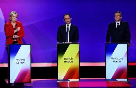 "From L-R, French presidential candidates, Marine Le Pen, French National Front (FN) political party leader, Benoit Hamon, of the Socialist Party, and Francois Fillon, member of the Republicans political party candidate of the French centre-right (R) attend the France 2 television special prime time political show, ""15min to Convince"" in Saint-Cloud, near Paris, France, April 20, 2017.  REUTERS/Martin Bureau"