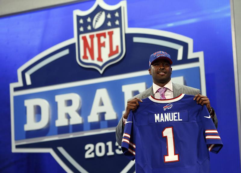 Quarterback E.J. Manuel from Florida State stands with the team jersey after being selected 16th overall by the Buffalo Bills in the first round of the NFL football draft, Thursday, April 25, 2013 at Radio City Music Hall in New York.  (AP Photo/Jason DeCrow)