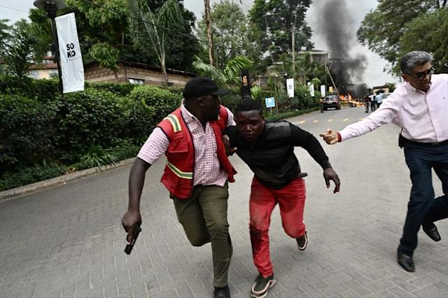 Survivors flee the scene of the attack on an upmarket hotel in the Kenyan capital (AFP Photo/SIMON MAINA)