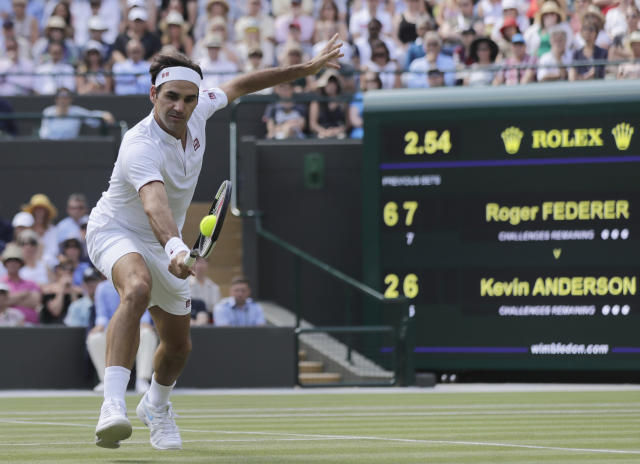 Switzerland's Roger Federer returns the ball to Kevin Anderson of South Africa during their men's quarterfinals match at the Wimbledon Tennis Championships, in London, Wednesday July 11, 2018. (AP Photo/Ben Curtis)