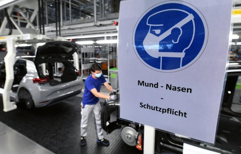 German manufacturers' saw their new orders fall a record 15.6 percent in March (AFP Photo/Hendrik Schmidt)