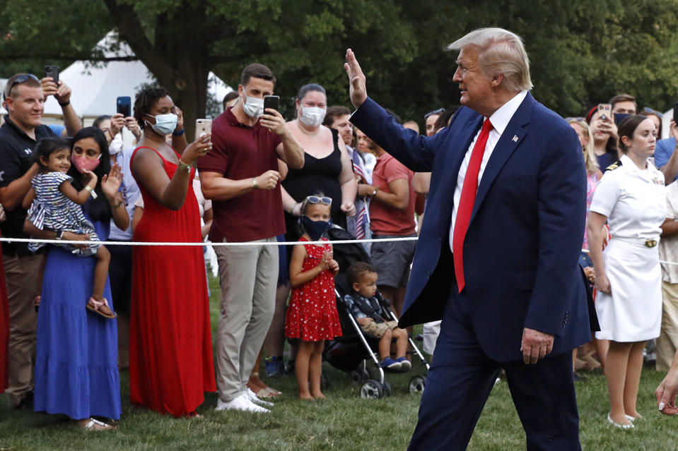 """President Donald Trump greets visitors as he walks on the South Lawn of the White House during a """"Salute to America"""" event, Saturday, July 4, 2020, in Washington. (AP Photo/Patrick Semansky)"""