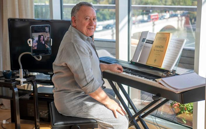 Brian Cohen having a piano lesson from his tutor Genia via Zoom. Mr Cohen is an orthopedic surgeon at a private hospital in the day - Paul Grover