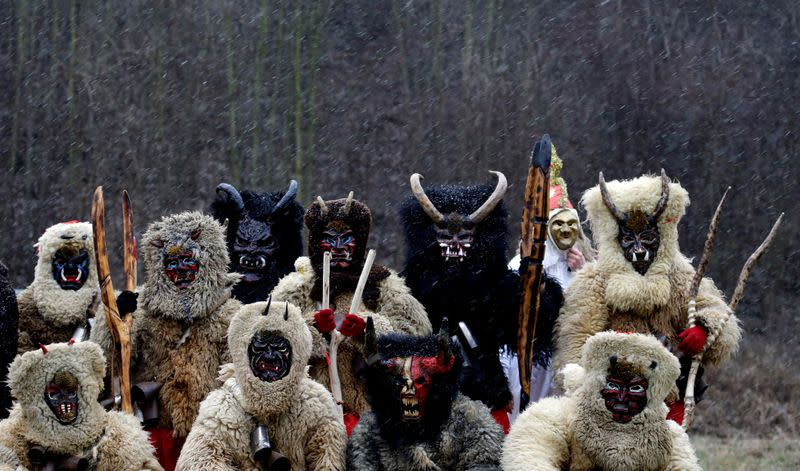 Revellers dressed as devils are seen in the village of Valasska Polanka