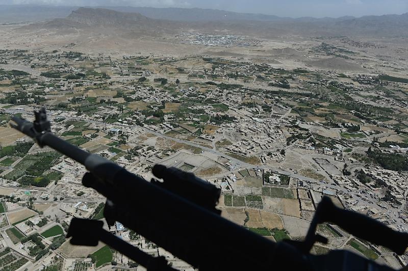 A US soldier's machine gun pictured from onboard a Chinook helicopter over the Gardez district of Paktia province, eastern Afghanistan, on August 11, 2014