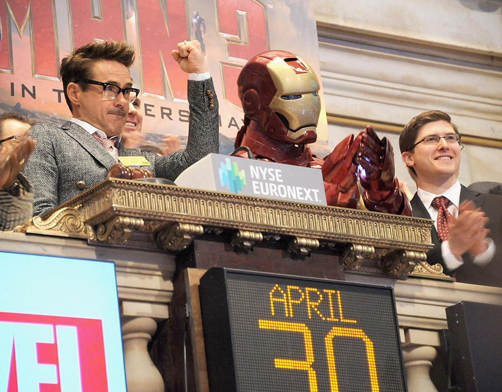 NEW YORK, NY - APRIL 30:  Actor Robert Downey (L) Jr.and the comic book character Iron Man ring the opening bell in celebration of 'Iron Man 3' at the New York Stock Exchange on April 30, 2013 in New York City.  (Photo by Gary Gershoff/WireImage)