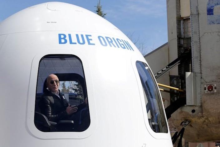 Jeff Bezos addresses the media about the New Shepard rocket booster and Crew Capsule mockup in 2017.