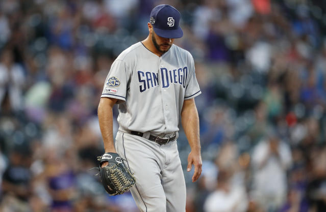 San Diego Padres starting pitcher Joey Lucchesi looks down after giving up a two-run home run to Colorado Rockies' Nolan Arenado during the first inning of a baseball game Friday, Sept. 13, 2019, in Denver. (AP Photo/David Zalubowski)