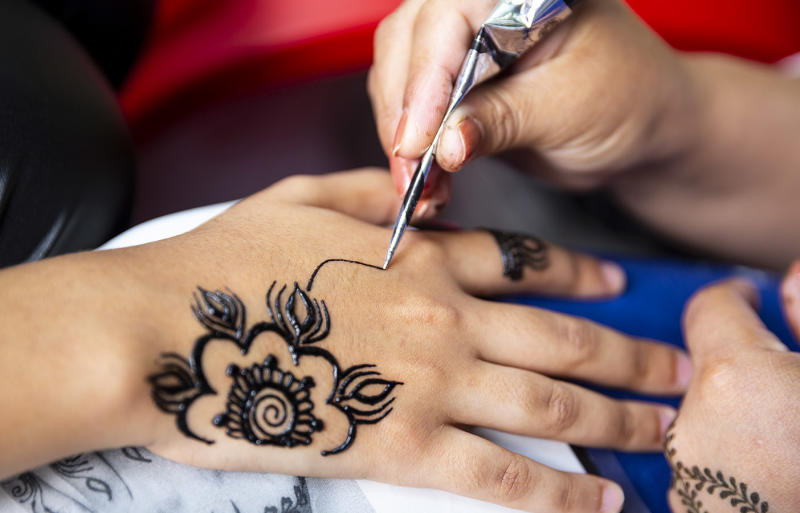 Pictured is a child getting a henna temporary tattoo, after a Perth mum warned her son was scarred after receiving a temporary tatt in Bali.