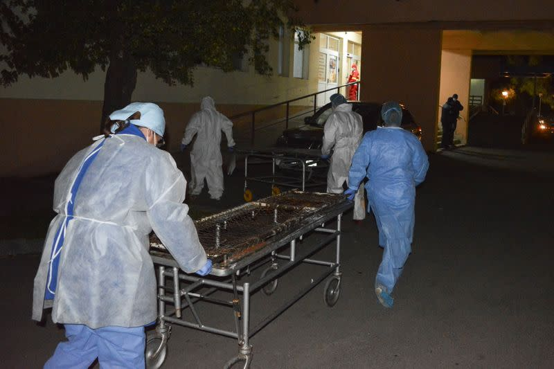 Medical staff rushes with stretchers to move the COVID-19 patients that where affected by a fire in the hospital in Piatra Neamt