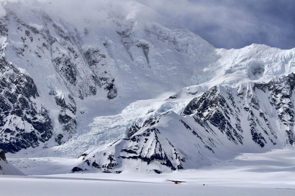 FILE - In this April 24, 2016, file photo, an airplane prepares to take off from an area where a base camp was being set up for climbers to begin their ascent of Denali near Talkeetna, Alaska. Talkeetna businesses are suffering in the financial pinch caused by the coronavirus, which led to the national park canceling this year's climbing season and the cancelation of summer seasons by most major cruise companies, meaning nearly half of Alaska's 2.2 million visitors had their trips canceled this year. (AP Photo/Mark Thiessen, File)