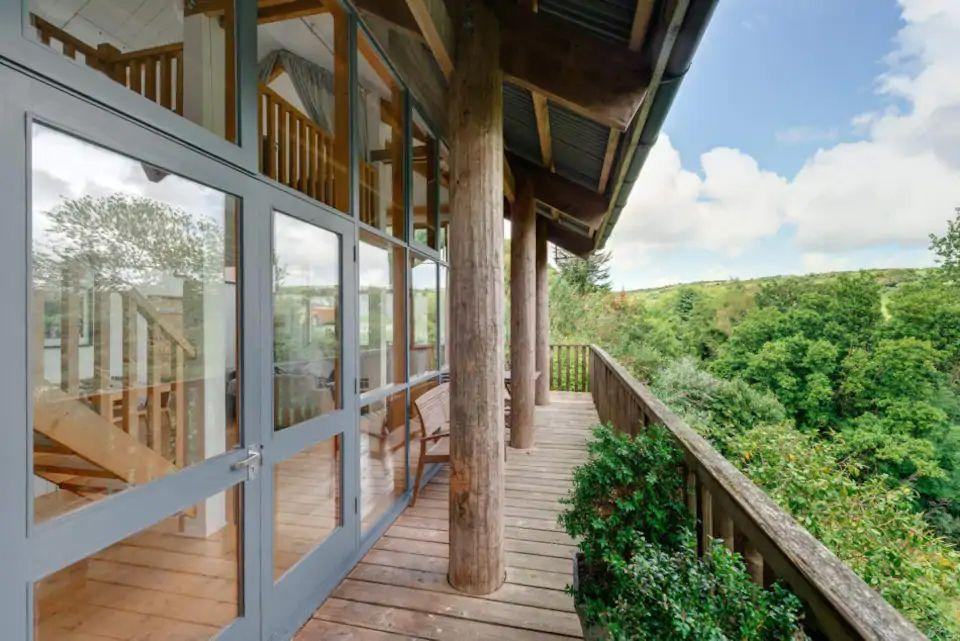 """<p>For one of Britain's best quirky staycations, visit Cornwall and reach new heights on a romantic treehouse escape for two. You can check into a gorgeous Airbnb, like this one near Penzance and St Ives, which offers a stunning views of gardens and the countryside from a balcony.</p><p>Inside, there are floor-to-ceiling windows, a large living area and an ensuite bedroom upstairs. It might not be a secluded lodge in the rainforest of Costa Rica, but it's the next best thing.</p><p><a class=""""link rapid-noclick-resp"""" href=""""https://airbnb.pvxt.net/jWW9ga"""" rel=""""nofollow noopener"""" target=""""_blank"""" data-ylk=""""slk:SEE INSIDE"""">SEE INSIDE</a></p>"""