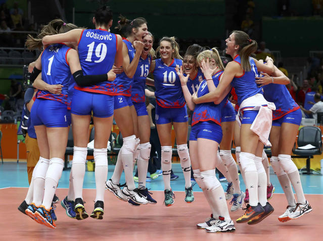 <p>Serbian players celebrate their victory against Russia in a women's volleyball quarterfinal in Rio on August 16, 2016. (REUTERS/Yves Herman) </p>