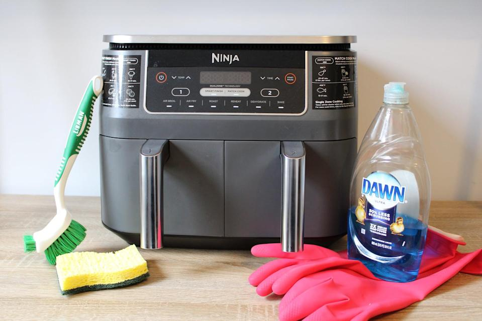 <p>This may seem simple, but we promise it deserves its own step! Let the air fryer cool completely before you clean it, and make sure it's unplugged as well. I like to remove the basket and set it on an oven mitt so that it cools faster than it would inside the machine.</p> <p>This is also a good time to prep your cleaning equipment. Don't use any abrasive materials like steel wool or metal utensils to clean the basket or scrape off food! Air fryers have a special nonstick coating and sharp cleaning utensils can damage it. Stick to gentle, non-abrasive tools like sponges or dishcloths.</p>