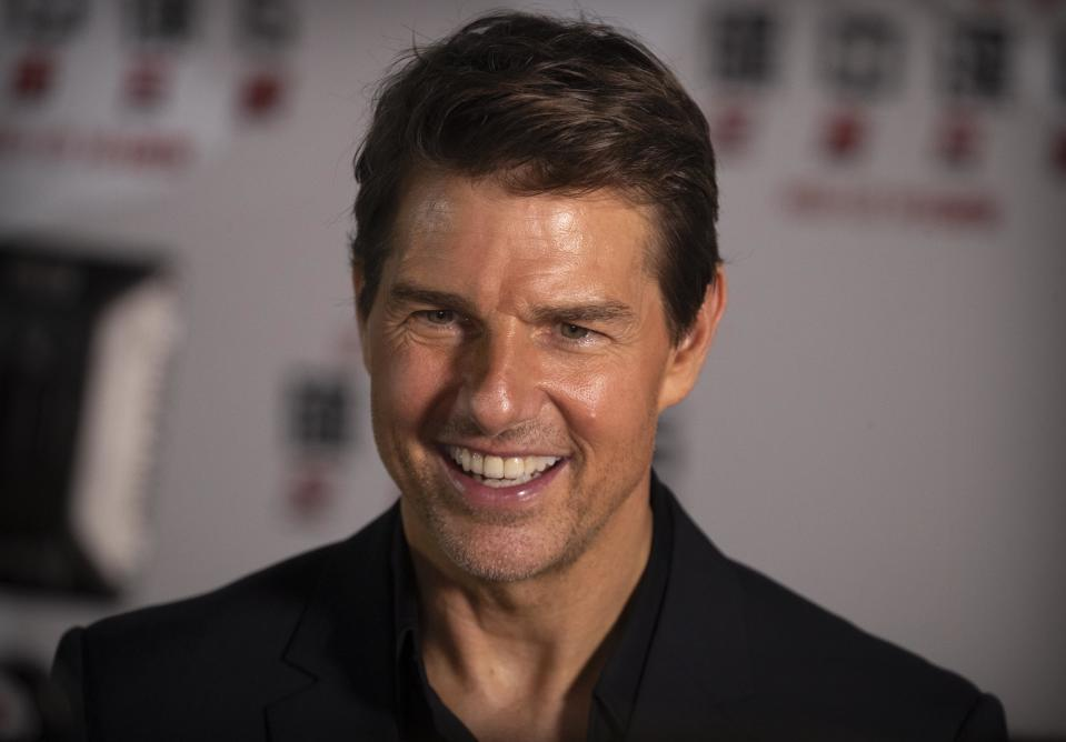 """Tom Cruise smiles as he gives an interview during a red carpet event for the movie """"Mission: Impossible - Fallout"""" at the Imperial Ancestral Temple in Beijing, China, Wednesday, Aug. 29, 2018. The film opens in China on Aug. 31. (AP Photo/Mark Schiefelbein)"""