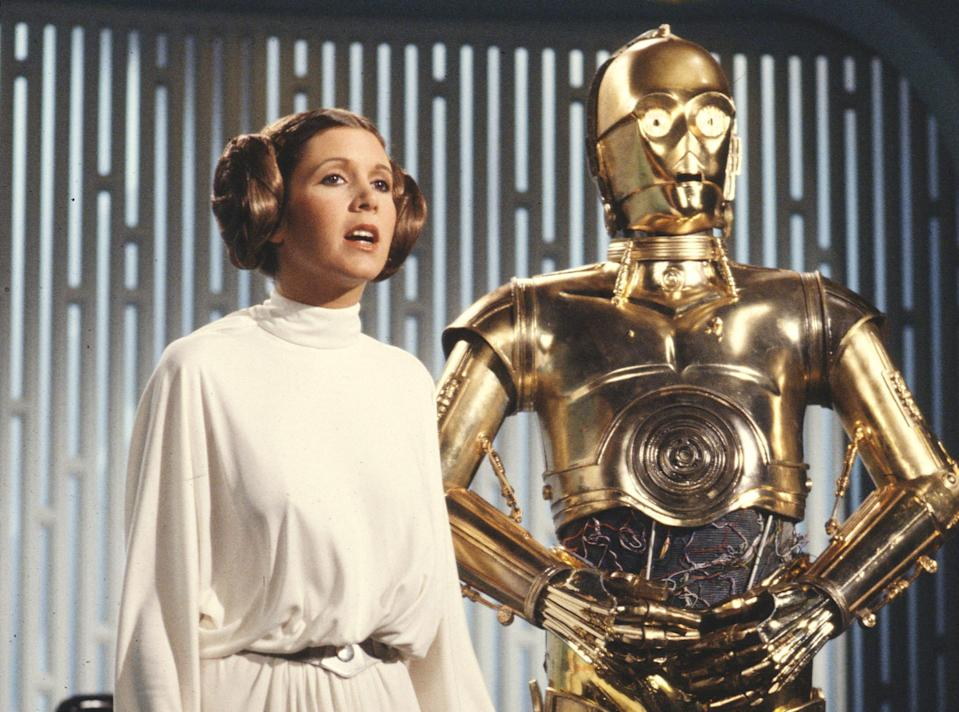 Carrie Fisher and Anthony Daniels in the notorious <em>Star Wars Holiday Special</em> (Photo by CBS via Getty Images)