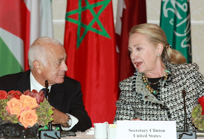 Secretary of State Hillary Rodham Clinton, right, welcomes Nabil Elaraby, left, Head of the Arab League as she hosts a gathering of Friends of Syria group on Friday, Sept. 28, 2012 in New York. (AP Photo/David Karp)