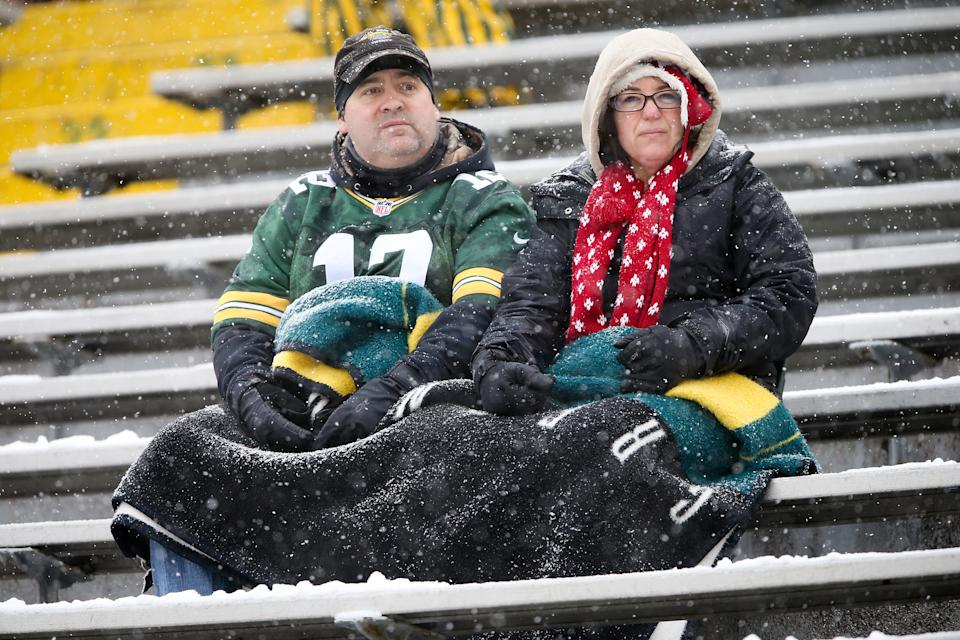 Packers fans sit in the Lambeau Field stands.