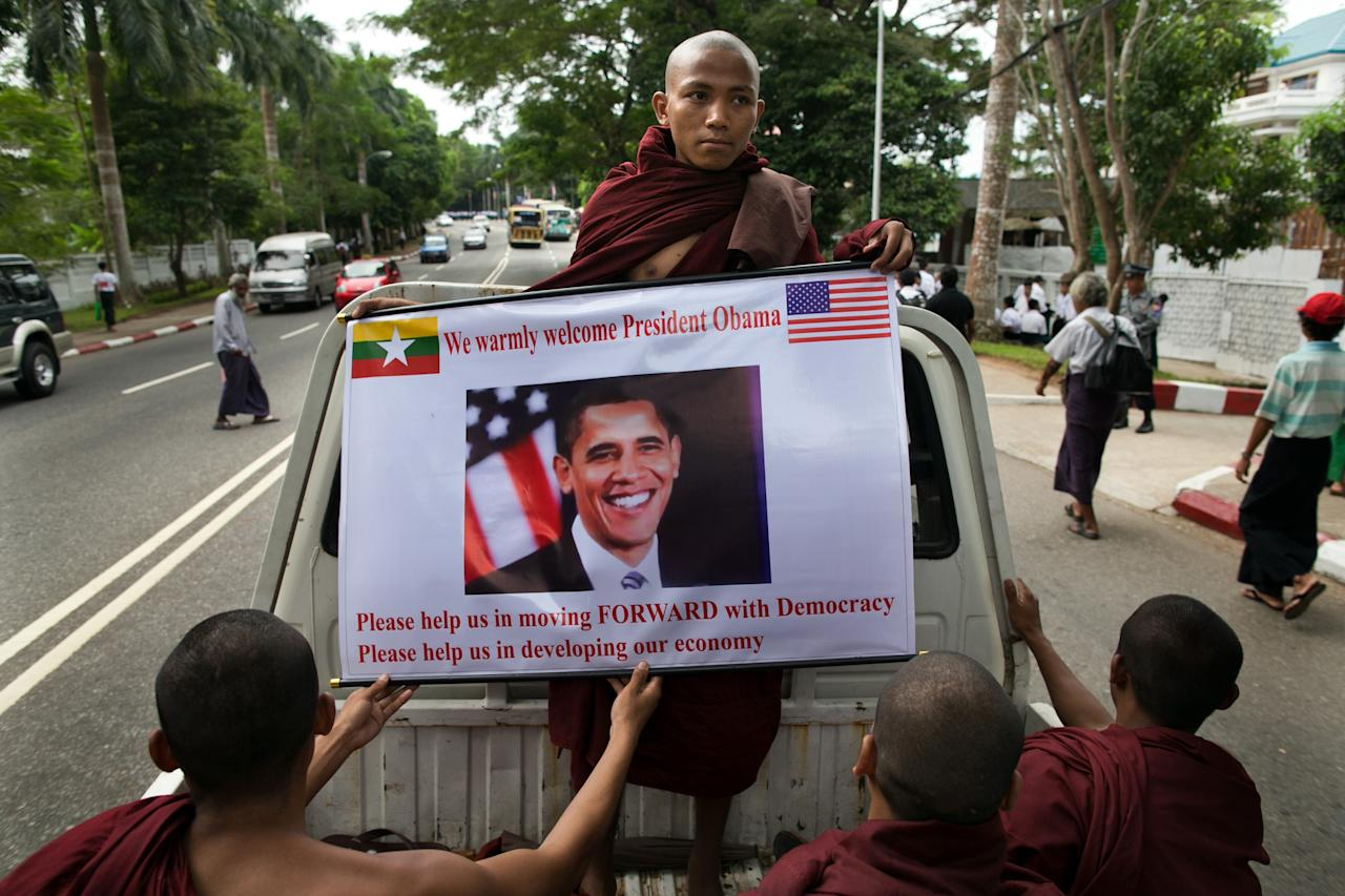 YANGON, MYANMAR - NOVEMBER 19:  Burmese monks hold a poster showing US President Barack Obama during his arrival at Yangon International airport for his historical first visit to the country on November 19, 2012 in Yangon, Myanmar. Obama is the first US President to visit Myanmar while on a four-day tour of Southeast Asia that also includes Thailand and Cambodia. (Photo by Paula Bronstein/Getty Images)